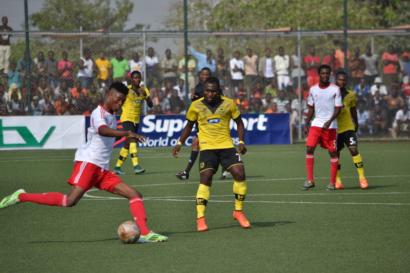 WAFA's Kennedy Boateng attempts to shoot against Asante Kotoko.