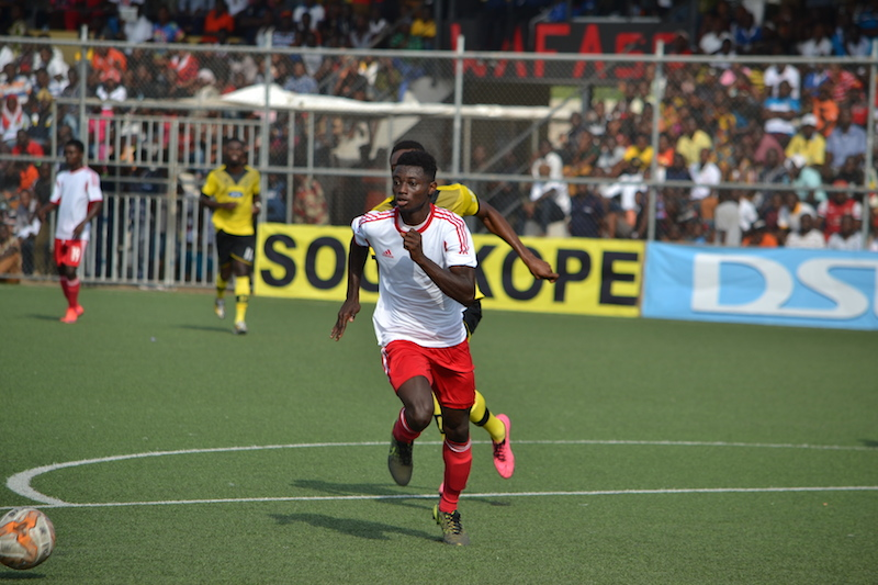 Gideon Mensah chases the ball at the WAFA Stadium.