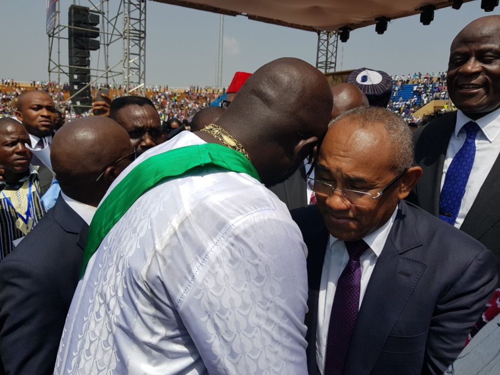 Ahmad is a hearty greeting with George Weah during the inauguration