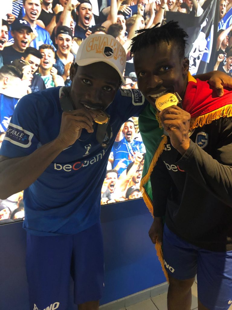 Paintsil (left) and Aidoo celebrate after receiving their medals and league title