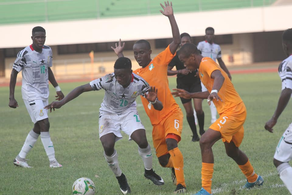 Togolese referee looks on in several attempts in Ghana players during the match