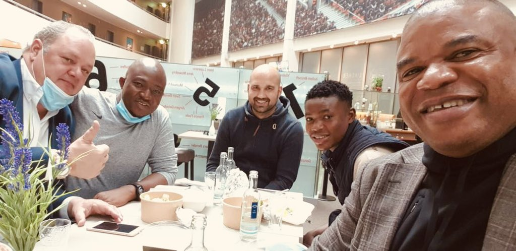Peter Obiora Ejiasi (far right) with Fatawu and others at the hotel in Germany booked by Leverkusen